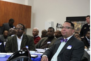 local pastors listen to speakers at the police department in richmond