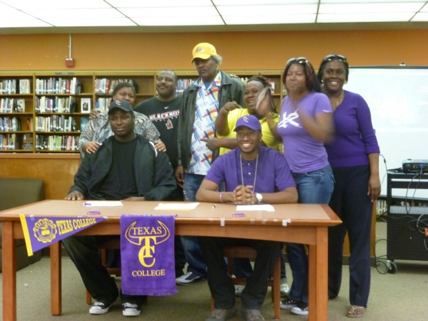Lenard Walden (left) and Eric Mims (right) pose with close family after signing letters of intent to attend Texas College. (Photo by Spencer Whitney)