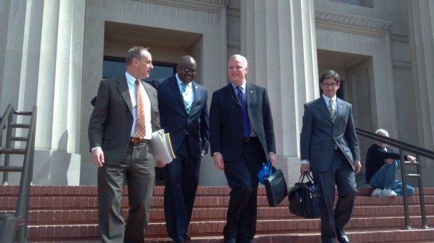 Pictured from left: Attorney Geoffrey Spellberg, RPD Deputy Chief Allwyn Brown, Chief Chris Magnus and Arthur Hartinger exiting court Tuesday afternoon. Photo by Robert Rogers.