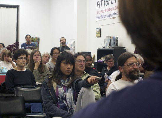 About 50 people attended, and nearly every chair in the small office was filled while the edges were scattered with observers. (Photo by: Stephen Hobbs)