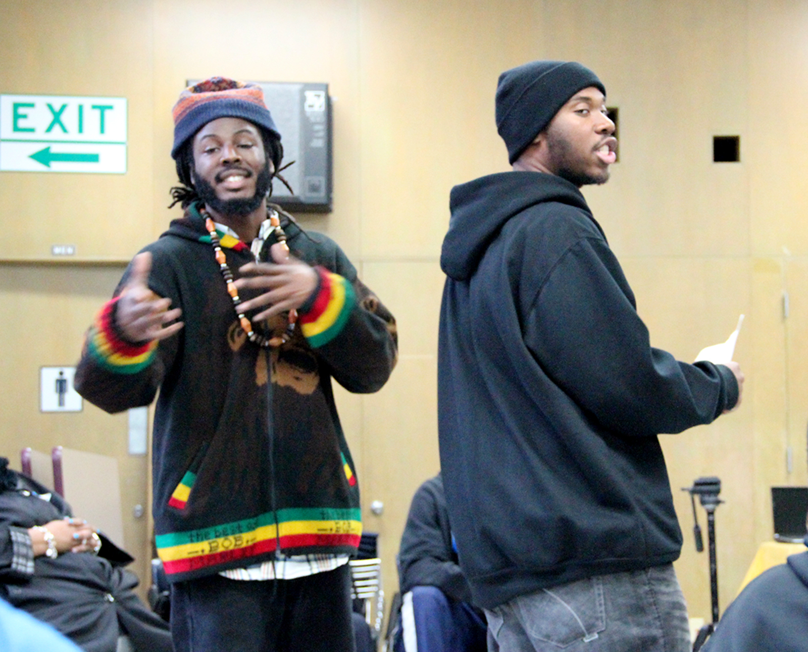Raw Talent, a spoken word group, performed three poems during the youth forum Saturday at the Richmond Library. (Photo by: Brittany Patterson)