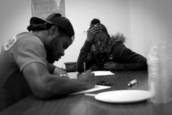 James Lane and RaShawn Clark work on their poems at the Phoenix Rysing workshop. (Photo by Sara Lafleur-Vetter)