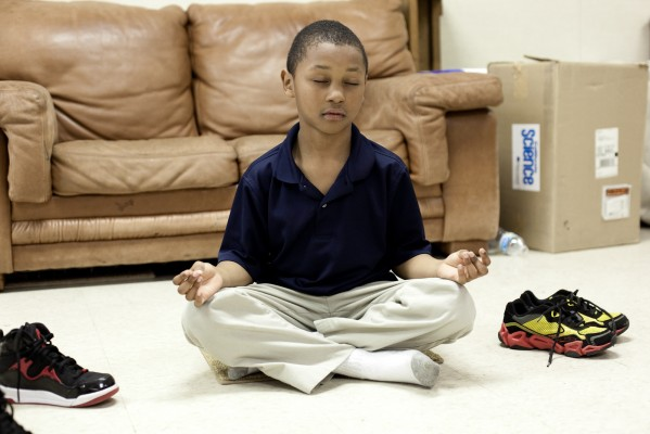 A Coronado Elementary second grader practices mindful breathing. (Photo by: Sara Lafleur-Vetter)