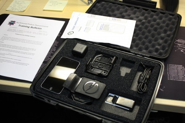 The body camera unit Richmond Police Officer Phillip Sanchez is testing is made by Taser International and comes with an iPod Touch for reviewing footage, a few clips to position the camera on the officer's uniform, a charger and an extra battery. This unit costs $299. (Photo by: Kevin N. Hume)