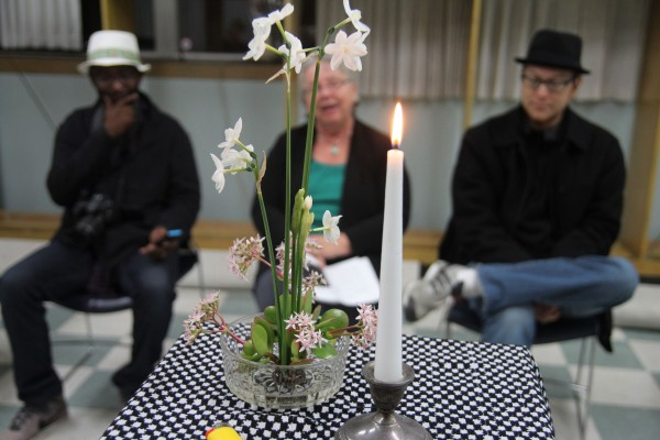 A small display of flowers and a candle serves as a memorial to the 16 people killed in Richmond this year during a Friday night ceremony led by Mayor Gayle McLaughlin at the city library's Madeline F. Whittlesey Community Room. (Photo by: Kevin N. Hume)