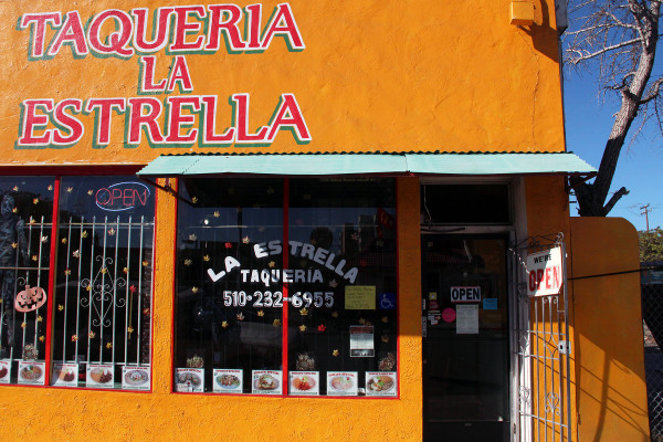Council member Gayle McLaughlin, a regular at Taqueria la Estrella, can't decide what her favorite dish is, but emphasizes the importance of small businesses, such as this one, in the city. (Photo by Angelica Casas)
