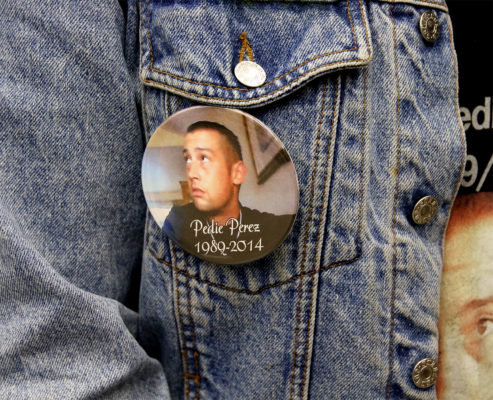"Cousin to Perez, Naomi Perez, wears several pins of her cousin Richard ""Pedie"" Perez."