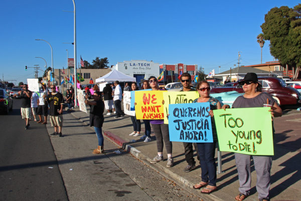 Attendees held signs for passing traffic to see and urged drivers to honk in support. Photo by Lauren Schwartzman.