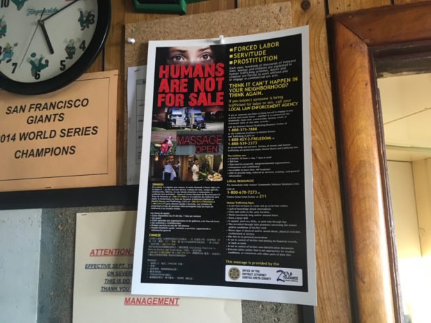 Human trafficking prevention poster on display at Jerry's Cocktail Lounge in Richmond. Photo by Angeline Bernabe.
