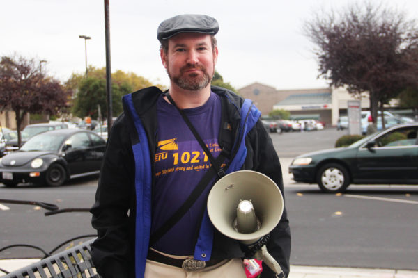 Dan Jameyson, SEIU Local 1021 chapter president for Contra Costa County, on strike at the Employment and Human Services Department's Richmond location. Photo by Alexandria Fuller.