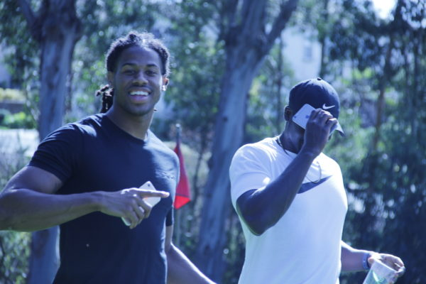Seth Roberts, left, wide receiver for the Oakland Raiders, on the green with a friend. Monday's event brought players from the San Jose Earthquakes, the Oakland Raiders and the San Francisco 49ers to Richmond to tee off at the course. Photo by Julia Vassey