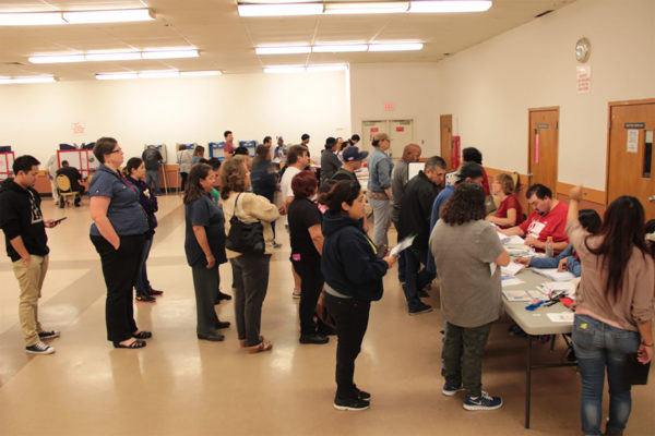 Richmond residents waited in line to cast their ballots at Veterans Memorial Hall this afternoon. Longtime voters said far more people seemed to turn out for this election compared to the last one. Photo by Grace Oyenubi.