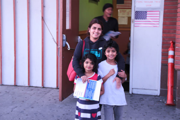 Richmond resident Sherin Ameerden, pictured with her children after casting her vote. Ameerden, who has taught in the Bay Area for the last 15 years, said the issue most important to her is the quality of education. Photo by Grace Oyenubi.