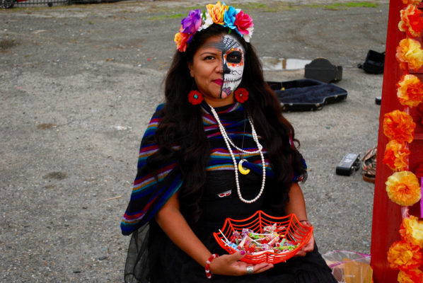 Trick or Treat on 23rd Street also celebrated Dia de los Muertos. A memorial altar was set up near the intersection of 23rd Street and Gaynor Avenue. Photo by Marian Davidson.